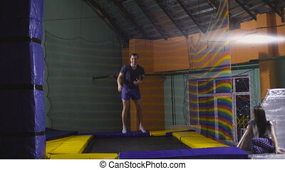 Jumping on trampoline. Young man. fun - A young man in a...