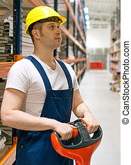 Forklift operator working in the warehouse.