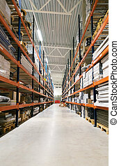 Warehouse storage racks with boxes and goods.