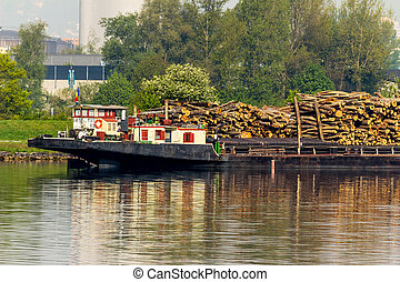 ship loaded with wood - loaded on a boat on the danube in...