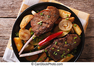 Beef steak with chili and fried potatoes closeup horizontal...