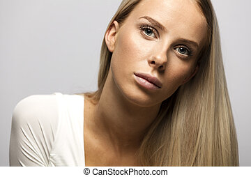 Portrait of a casual blonde woman in white top - Beautiful...