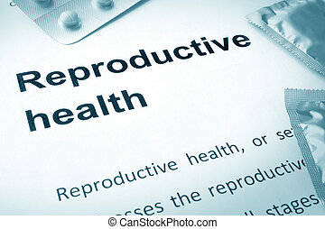 reproductive health - Paper with words reproductive health...