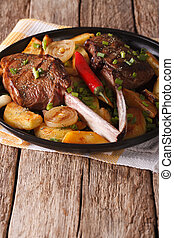 Grilled beef steak with fried potatoes on a plate close-up...