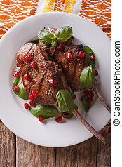 Grilled beef steak with pomegranate closeup on a plate...