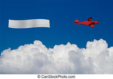 Beach plane with banner - Red plane pulls blank banner above...
