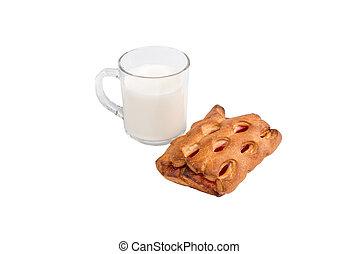 glass mug with milk and a bun with jam