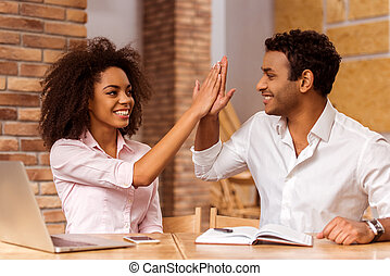 Attractive Afro-American couple working - Young attractive...
