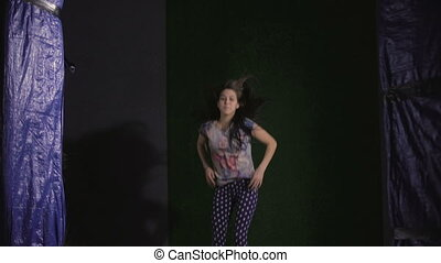 Jumping on trampoline. Young woman. fun - A young woman in a...