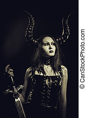Infernal beauty - Horned beautiful gothic girl posing over...