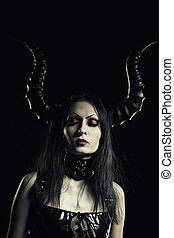 Mistress in black - Horned seductive girl posing over dark...