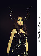 Horned mistress - Horned young girl in latex dress posing...