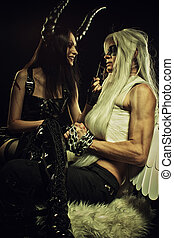Demons slave - Seductive girl in latex with horns and her...