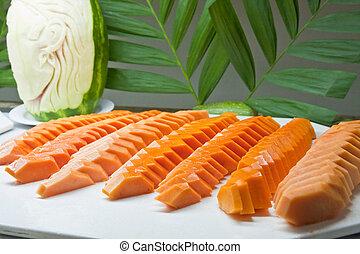 Sliced Papayas on a Tray - Sliced papaya on a tray on a...