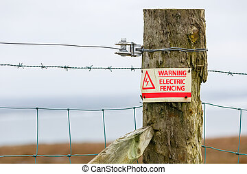 Electric fence danger warning sign - Photo of electric fence...