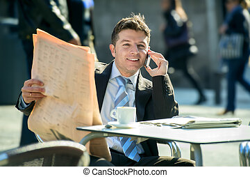businessman on street bar having breakfast coffee reading newspaper news talking on mobile phone