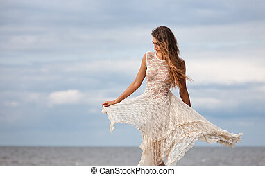 girl in a semitransparent dress against the sea - Beautiful...