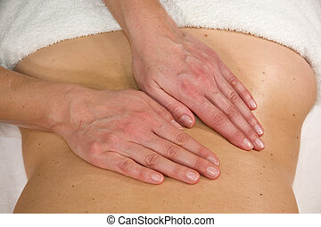 massage at lumbar region - a natural mature woman having a...