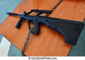Steyr AUG riflel Its an Austrian bullpup 556×45mm NATO...