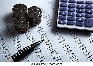 money in the form of banknotes and coins with calculator...