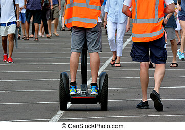 Man ride Segway PT in crowded place.Segway PTs can reach a...