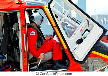Rescue Helicopter pilot sit in the cockpit