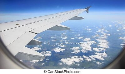 view from the window of an airplane flying