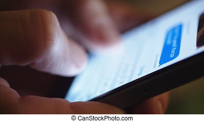 woman typing text on a smartphone, close-up - close up of...