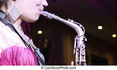 girl playing the saxophone at the club