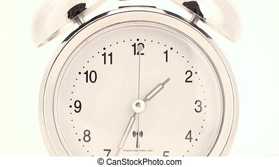 Alarm clock in time lapse - Silver alarm clock in time lapse...