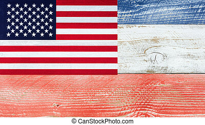 American flag with national colors painted on fading wooden boards