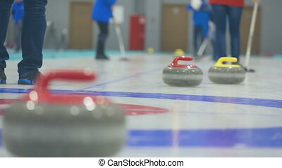 Curling stones on ice - Close up of Curling stones sliding...