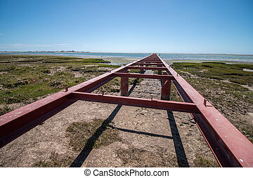 Unfinished bridge on the marshlands of Ria Formosa, Portugal...