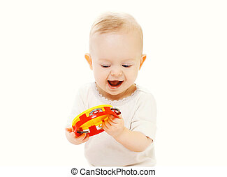 Happy smiling baby playing with toy on a white background