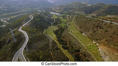 4K Aerial, View on golf course and hairpin bends, Andalusia, Spain