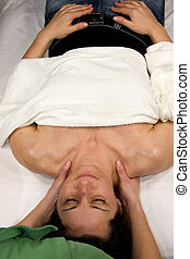 massage of neck and shoulder muscles