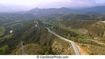 4K Aerial, View on golf course and hairpin bends, Andalusia,...