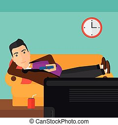 Man lying on sofa. - A man lying on a sofa and watching tv...
