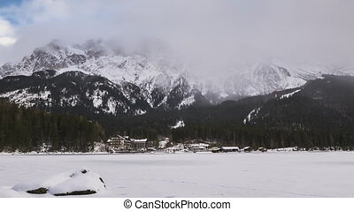 clouds at lake Eibsee in winter in a timelapse movie