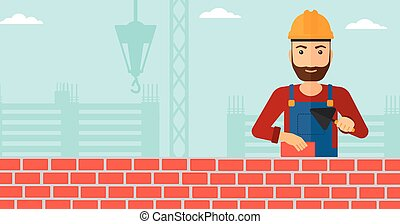 Bricklayer with spatula and brick - A hipster bricklayer...