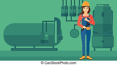 Cheerful repairer with spanner - A female repairer engineer...