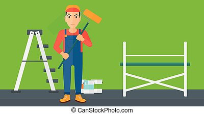 Painter with paint roller - A man standing with a paint...