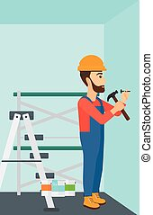 Constructor hammering nail - A hipster man with the beard...