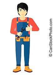 Cheerful repairman with spanner - An asian repairman...