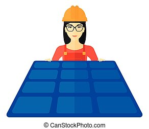 Constructor with solar panel - An asian constructor with...