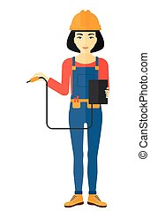 Electrician with electrical equipment - An asian electrician...