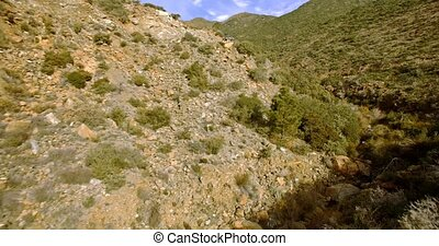 4K Aerial, Flight along hills and rocks, off the beaten track, Andalusia, Spain