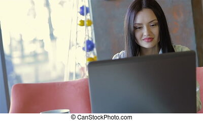 A young business woman using her laptop