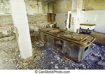 old kitchen - view of a dilapidated abandoned kitchen...