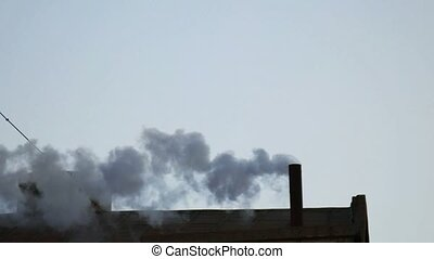Smoking Chimney. - Smoking Chimney on the roof of the...